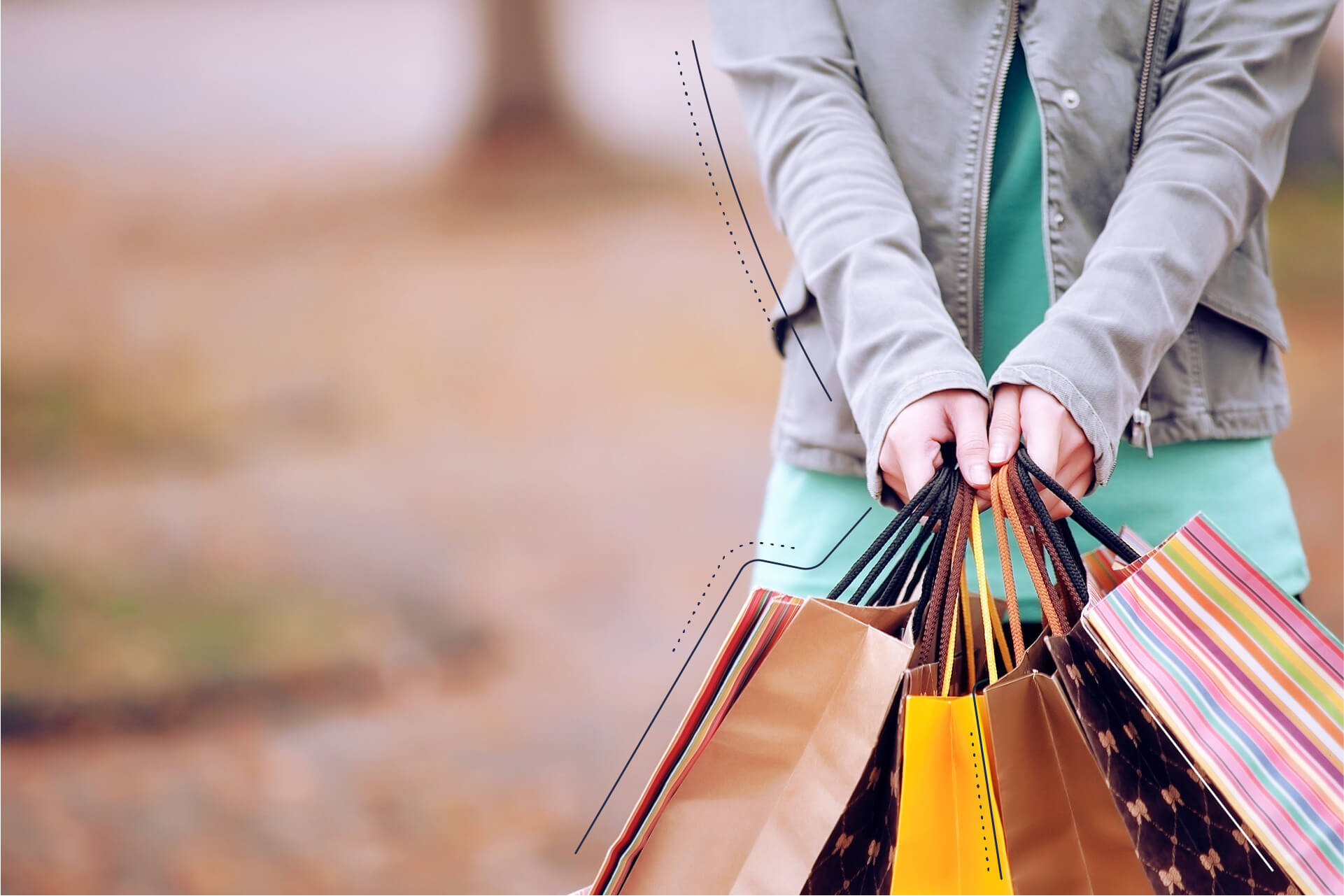 Bild von vielen Einkaufstüten die von 2 Händen zusammengehalten werden.   eggheads.net