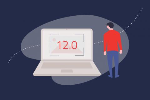 Illustration eines Mannes der neben einem Laptop steht auf den 12.0 geschrieben steht. | eggheads.net